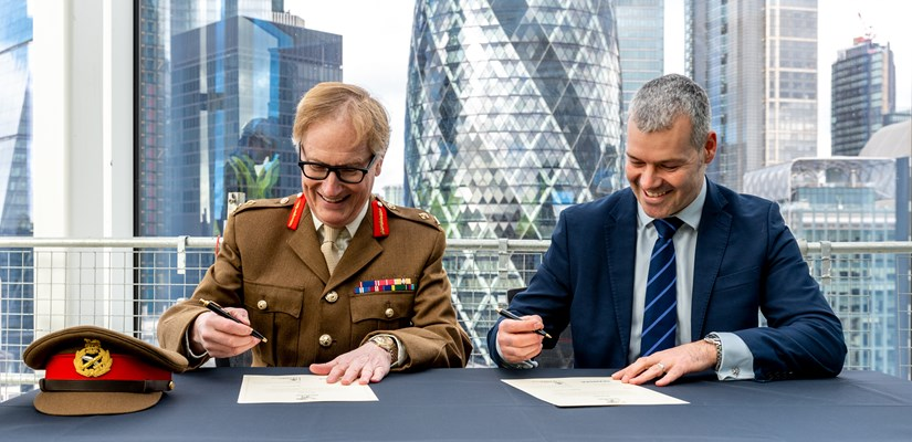 Steve Holbrook and Major General Simon Brooks-Ward sign the covenant