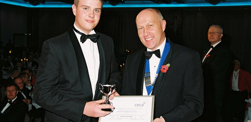 John Breheny, Chairman of CECA (Southern) presents Charlie Streater with his award