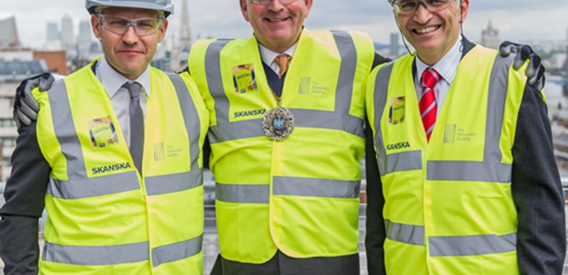 Andreas Lindelöf, Managing Director of Project Development, The Lord Mayor of the City of London, Alderman Alan Yarrow and Mike Putnam, Chief Executive and President of Skanska UK celebrate The Monument Building topping out.