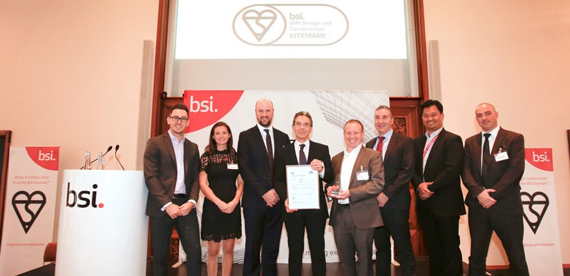 David Thorssell, BIM and Digital Engineering Operations Manager (centre holding certificate) with Skanska UK BIM leads
