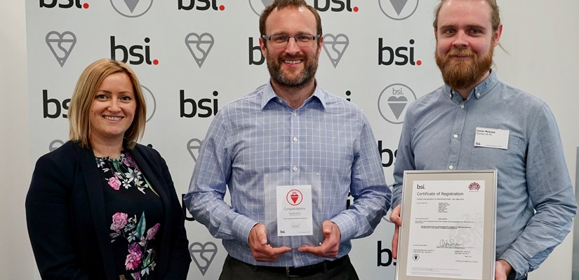 Skanska UK's Director of Environment, Adam Crossley (centre) and Carbon Manager, Conor McCone (right) with BSI's UK Product Certification Director, Natasha Bambridge