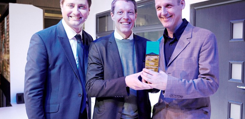 Andreas Nolin, Homes by Skanska (centre) collecting the award from channel 4 presenter George Clarke (left) with Michael Richter, Formation Architects.