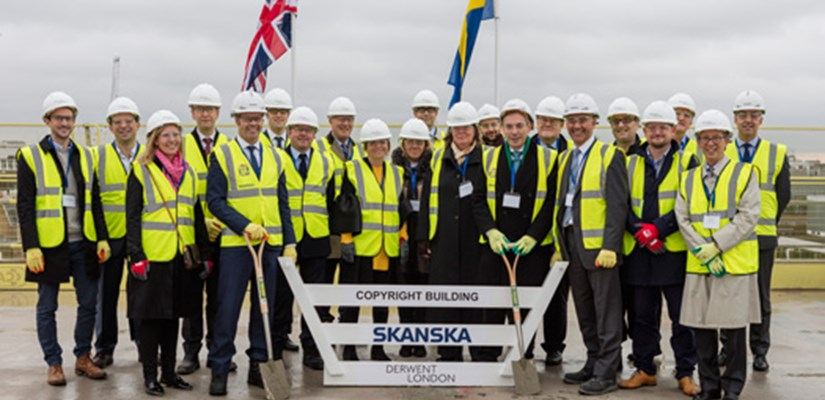 Representatives from Skanska, Derwent London and partners celebrate the topping out