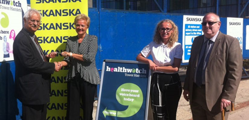 Allison Newell, Health & Care strategy director with Dianne Barham, Healthwatch Tower Hamlets and co-chairs David Burbidge and Amjad Rahi open the new Healthwatch hub portacabin, donated by Skanska.