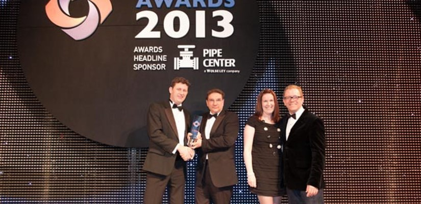 David Mason and Becki Taylor collecting award