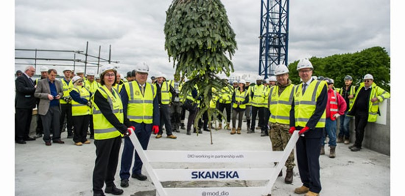 Key stakeholders from the MOD and DIO celebrate the Worthy Down College Building topping out with Skanska MD Terry Elphick
