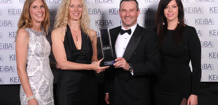 Jenny Coleville, Kent County Council (pictured far left) and Rachael Baldwin (pictured far right) presenting the KEiBA award to Craig Nimmo and Alison Clarke from Canterbury College