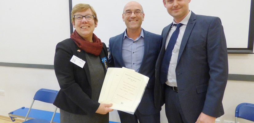 Mike Carter (centre) and Matt Parsons from Childs and Sulzmann architects receives the award from RCAS's Helen Wilde