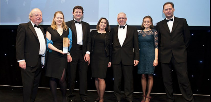 Skanska's David Mason (third from left) and Alice Tuddenham (second from right) receiving the award with M&E Real Estates.