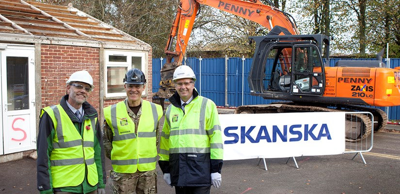 Simon Gadd (DIO Head of Programmes and Projects), Commandant DCLPA Brig Allan McLeod and Terry Elphick, Skanska managing director, mark the start of the demolition phase at Worthy Down