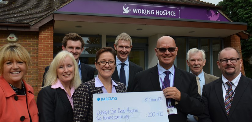 Katy Dowding and Nigel Harding (holding cheque) pictured with the facilities services team