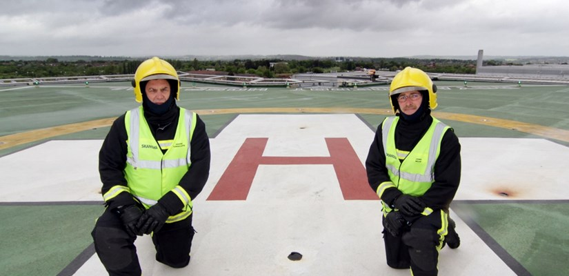 Martin Tunnicliffe and John Mead on the rooftop helipad above the hospital