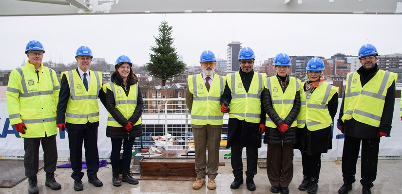 Distinguished guests celebrate the topping out for the Zayed Centre for Research into Rare Disease in Children at Great Ormond Street Hospital.